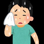 汗を拭う男性